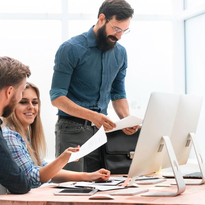 Project Manager and business team discussing business documents. The concept of teamwork royalty free stock photo