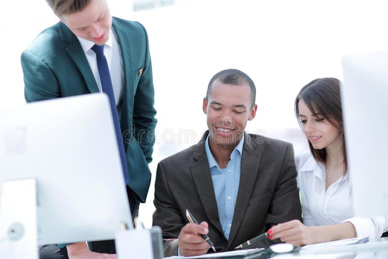 Project Manager and business team discussing work documents. In the office royalty free stock photo