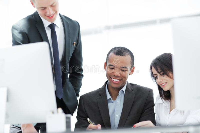 Project Manager and business team discussing work documents royalty free stock images