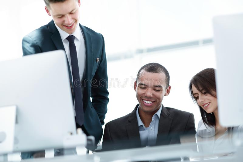 Project Manager and business team discussing work documents stock photo