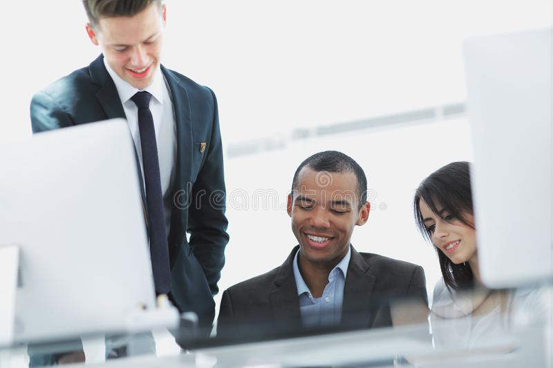 Project Manager and business team discussing work documents. In the office royalty free stock image
