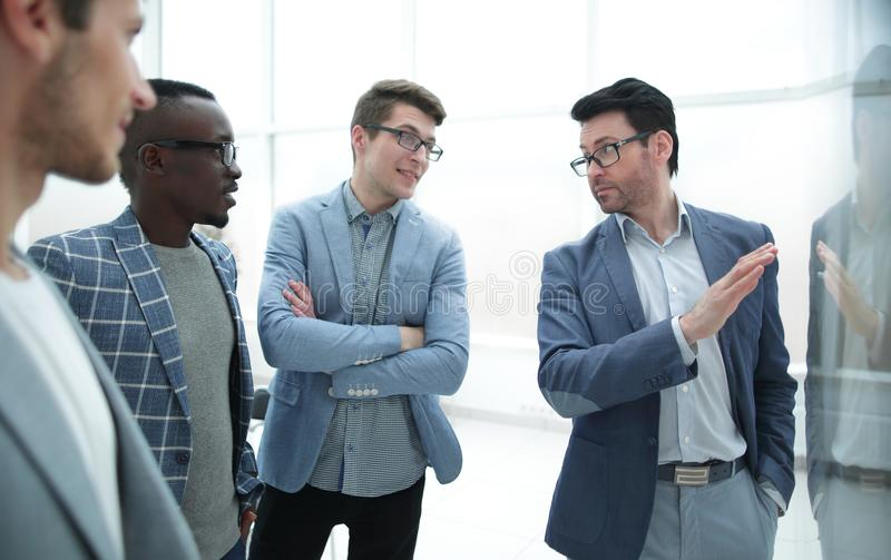 Project Manager and the business team are discussing work problems stock photos