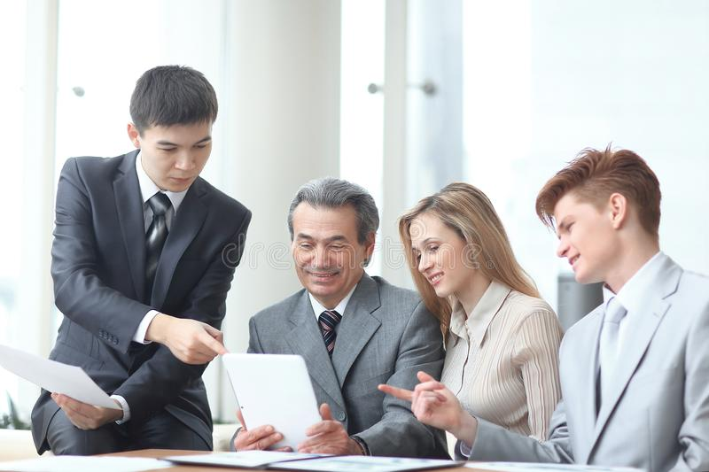 Project Manager and business team use a digital tablet to obtain operational information stock image