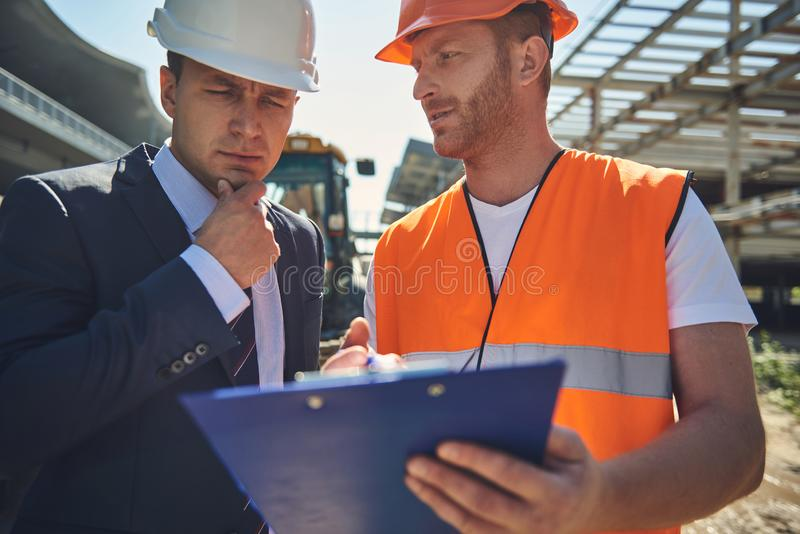Project manager is communicating with worker man royalty free stock photography