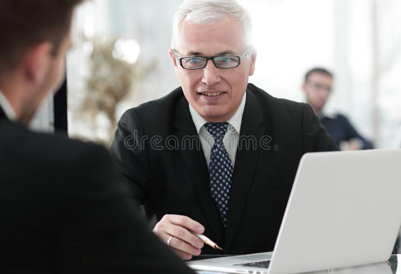 Project Manager conducts an interview with a new employee stock photography