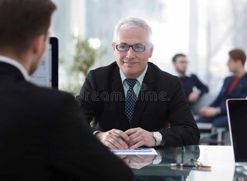 Project Manager conducts an interview with a new employee. In a modern office royalty free stock image