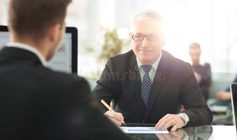 Project Manager conducts an interview with a new employee. In a modern office stock images