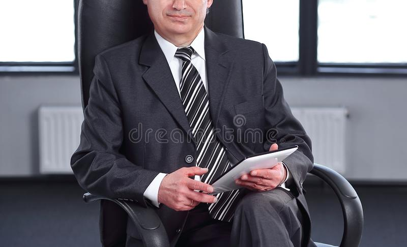 Project Manager with digital tablet sitting in office royalty free stock photography