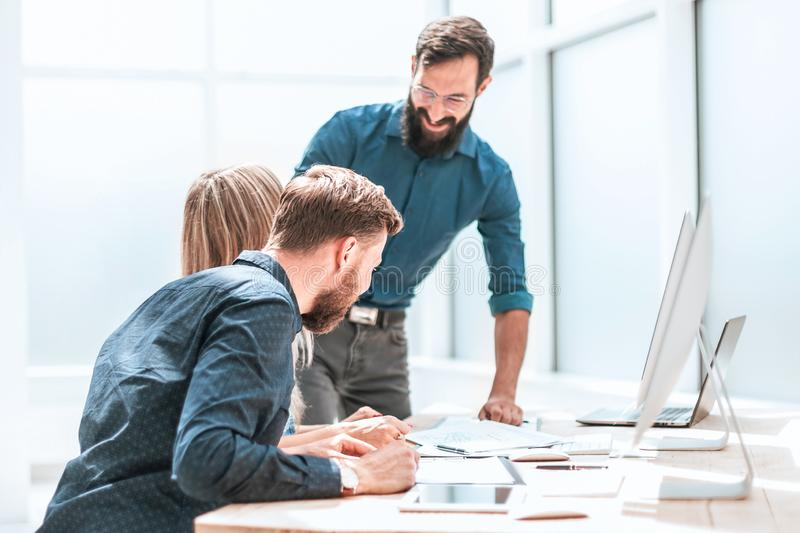 Project Manager discussing with business team business documents stock photography