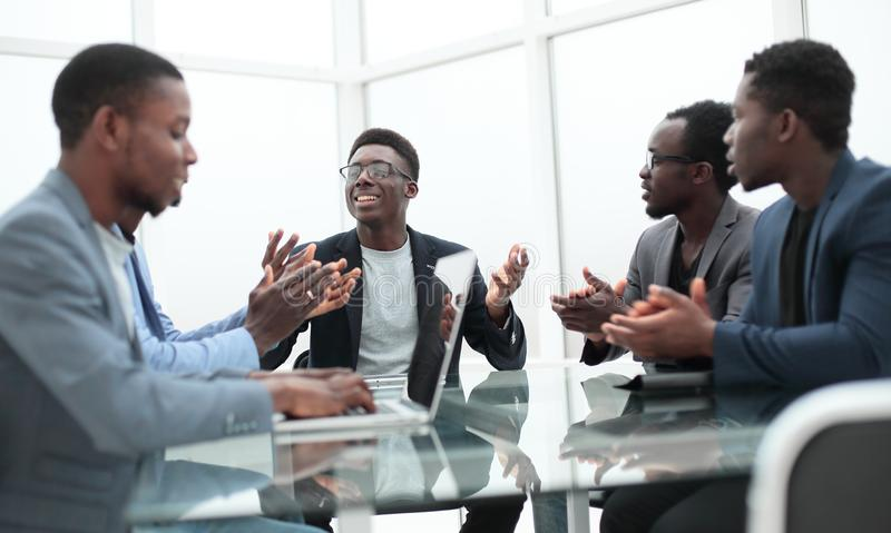 Project Manager explaining something to employees at an office meeting stock photo