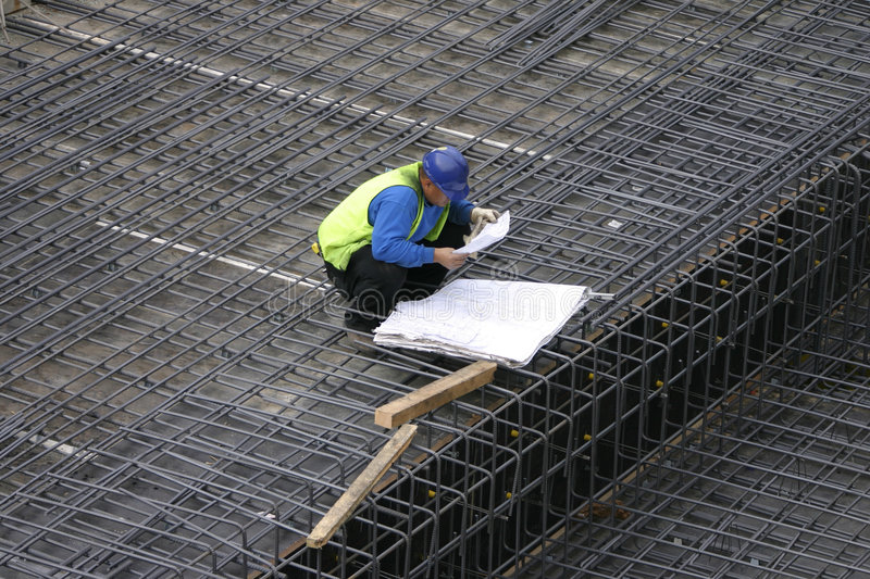 Project Manager reading the site plans. The site manager reads the building plans royalty free stock photography