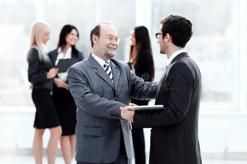 Project Manager shaking hands with the employee prior to the seminar royalty free stock photo