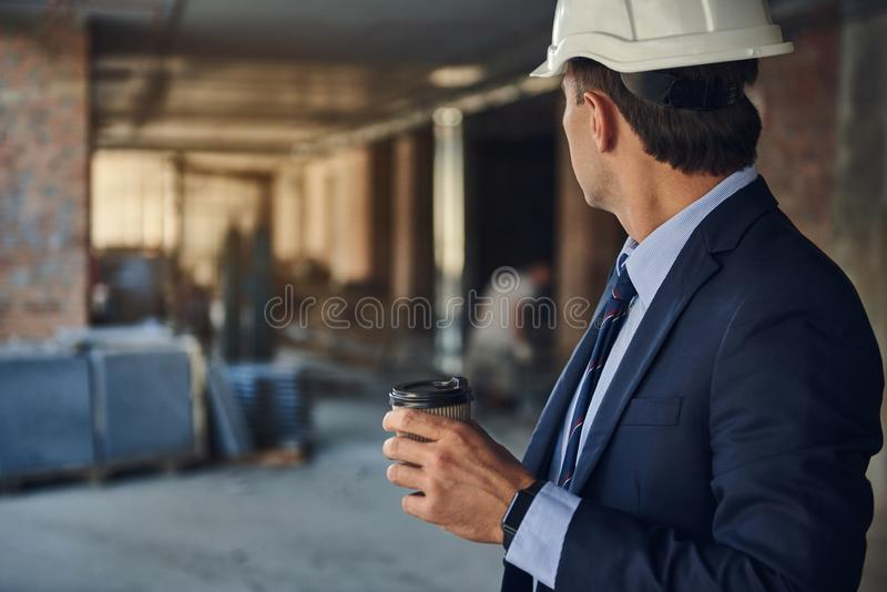 Project manager is spending work time on facility stock photo