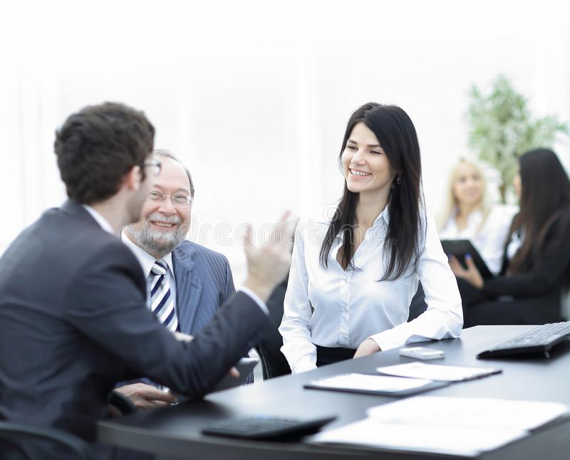 Project Manager and staff talking at the Desk. Teamwork royalty free stock photography