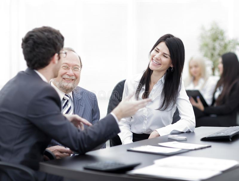 Project Manager and staff talking at the Desk. Teamwork stock photo