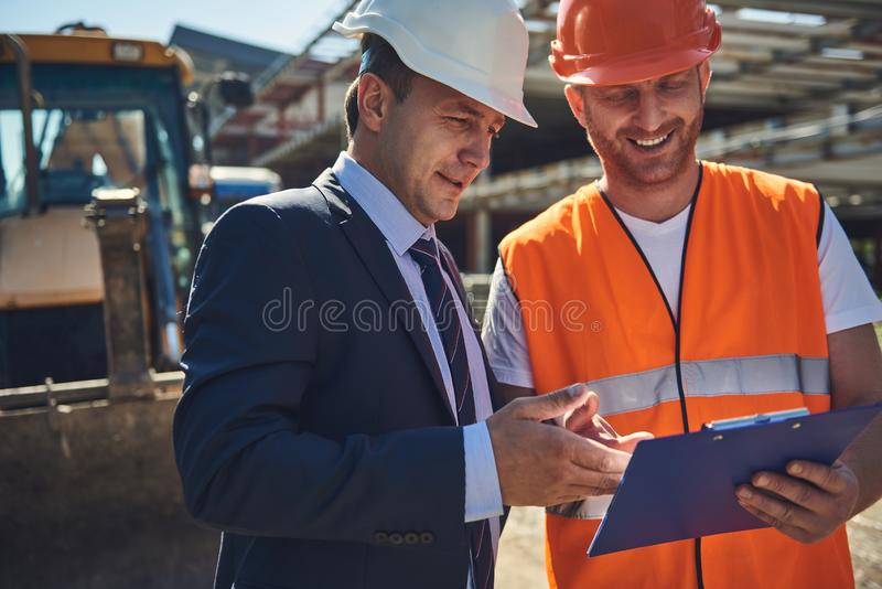 Project manager is talking with builder outdoor royalty free stock image