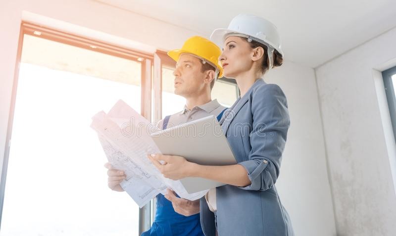 Project owner and construction worker during acceptance stock photos