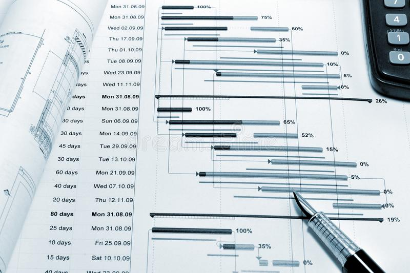 Project planning - blueprint. Construction project planning, drawing, calculator and a pen royalty free stock photos