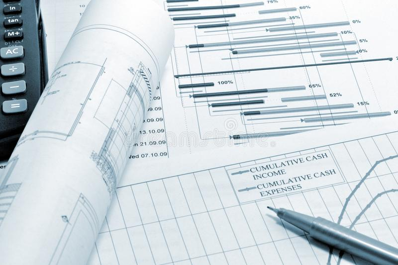 Project planning - blueprint. Construction project planning, drawing and calculator stock images