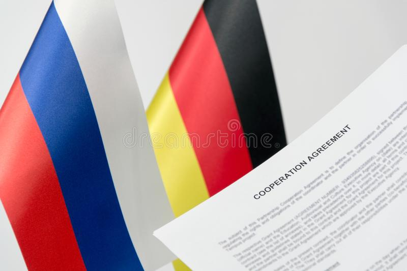 Project russia germany flag. Gas pipeline nord stream 2 blurred background stock photo