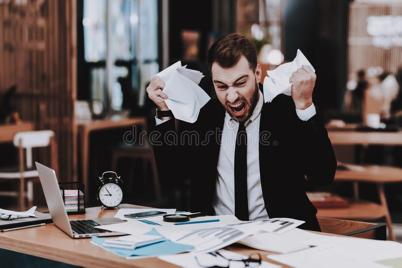 Project. Upset. Large Amount of Work. Business. Project Upset. Large Amount of Work Business Suit. Workplace Ideas Laptop Sit. Brainstorm Young Guy Businessman royalty free stock images
