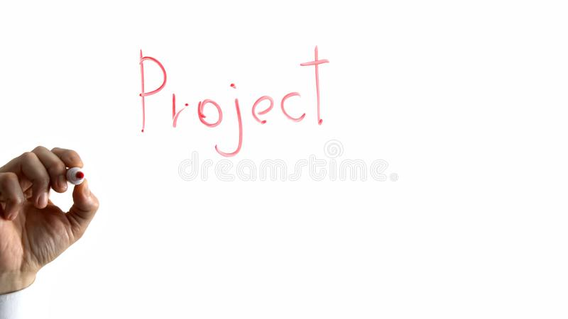 Project word on glass, hand writing with felt pan, startup business development stock images