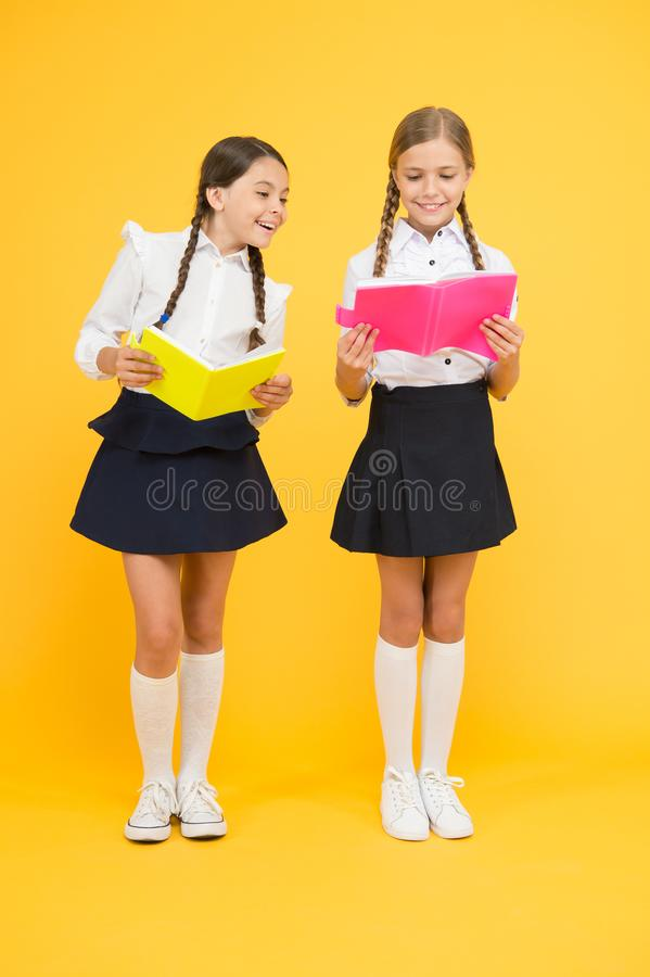 Project work together. literature lesson. small girls kids with book. reading and writing. back to school. Classmates at royalty free stock photo