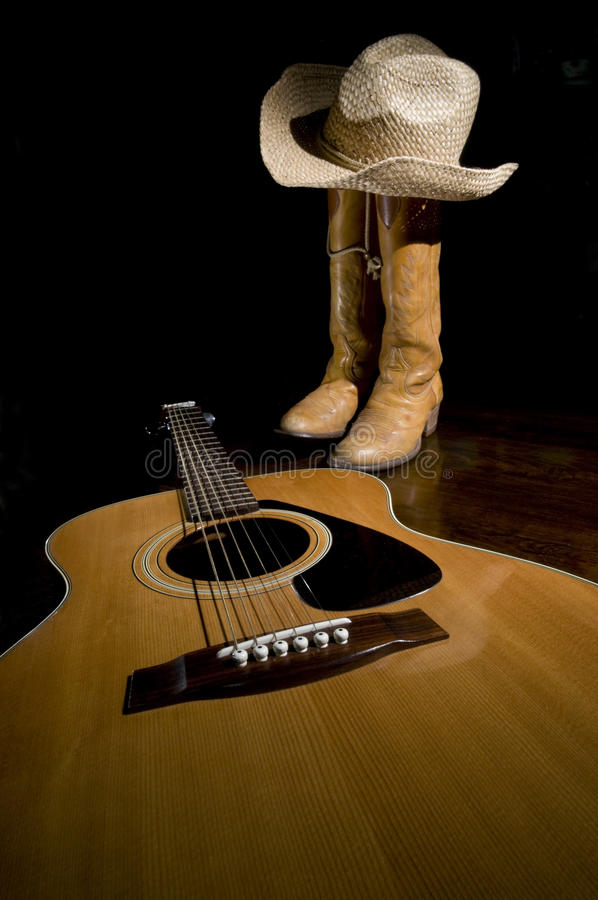 Gaines de guitare et de cowboy images libres de droits