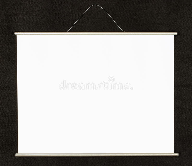 Projection screen. Empty projection screen on a black wall stock photo