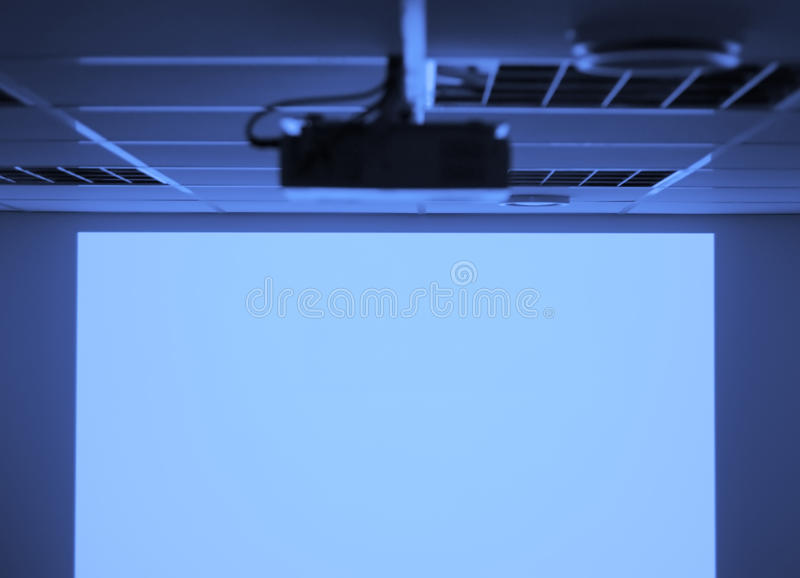 Projector. Digital projector and blank screen royalty free stock image