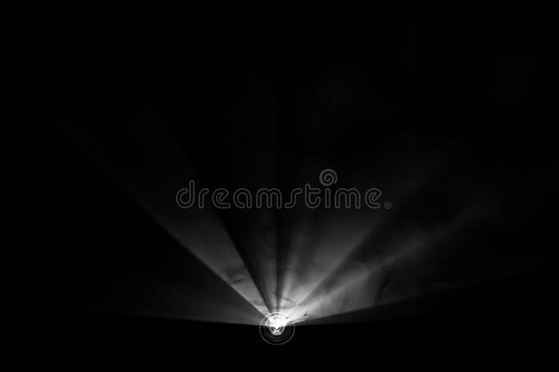 Projector beautiful black and white lighting . wide lcd lens equipment for show presentation at night . smoke abstract background royalty free stock images