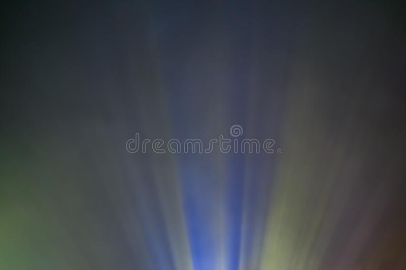 Projector colored light beam through smoke for movie and cinema at night. Close view royalty free stock images