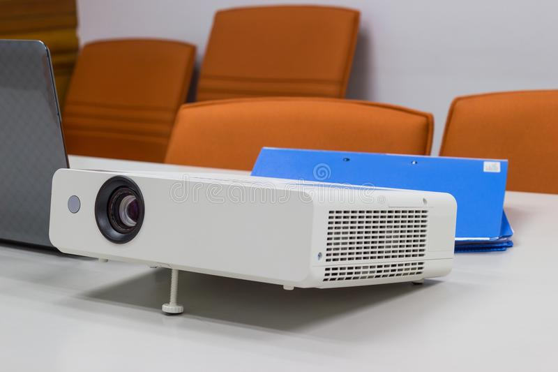 Projector connected to Laptop with file folder on the table in a meeting room. Business Concept royalty free stock photos