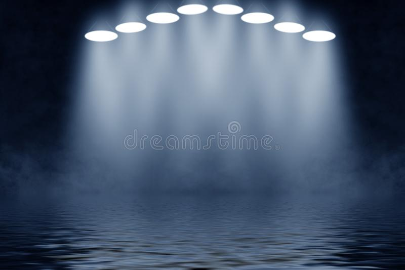 Projector spotlight with reflection in water. Isolated on black background royalty free stock image