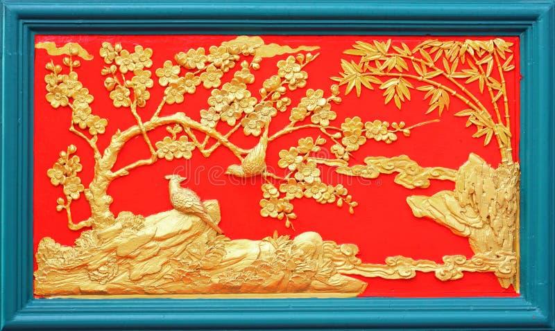 Projeto do estuque do ouro do estilo chinês nativo fotografia de stock