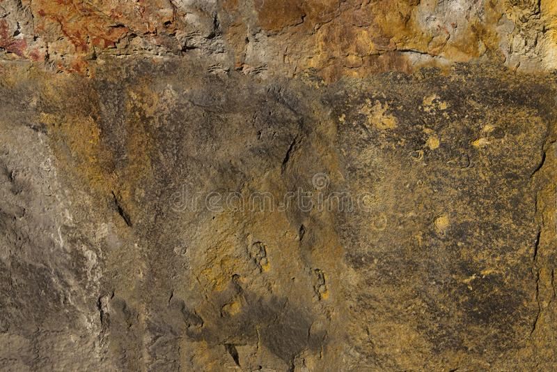 Projeto monolítico resistido velho da pedra de superfície da base do grunge do fundo do cimento fotografia de stock