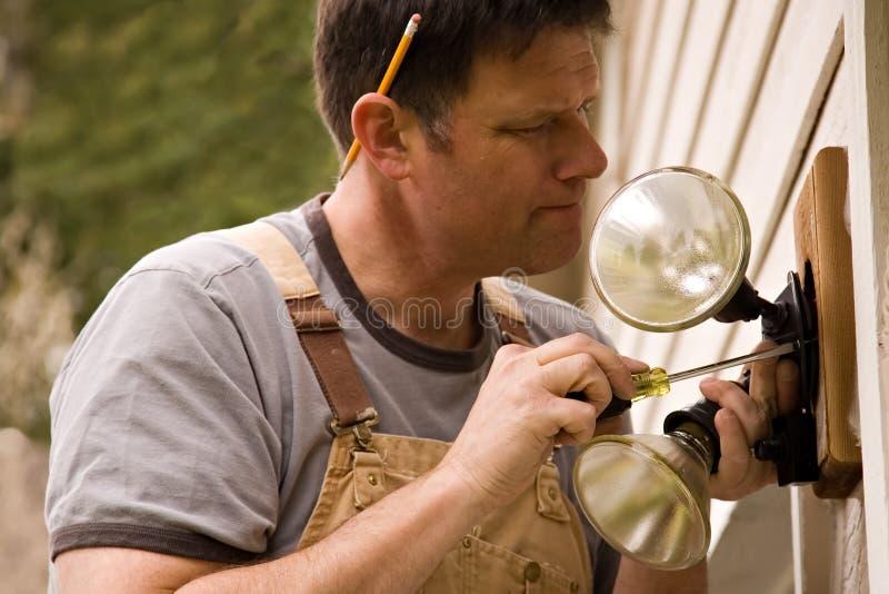 Projetos home do trabalhador manual imagens de stock