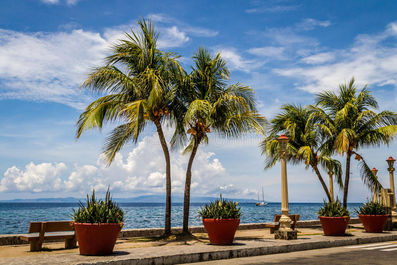 The promenade along Rizal Boulevard, City of Dumaguete, Philippines. Promenade along Rizal Boulevard, City of Dumaguete, Philippines royalty free stock image