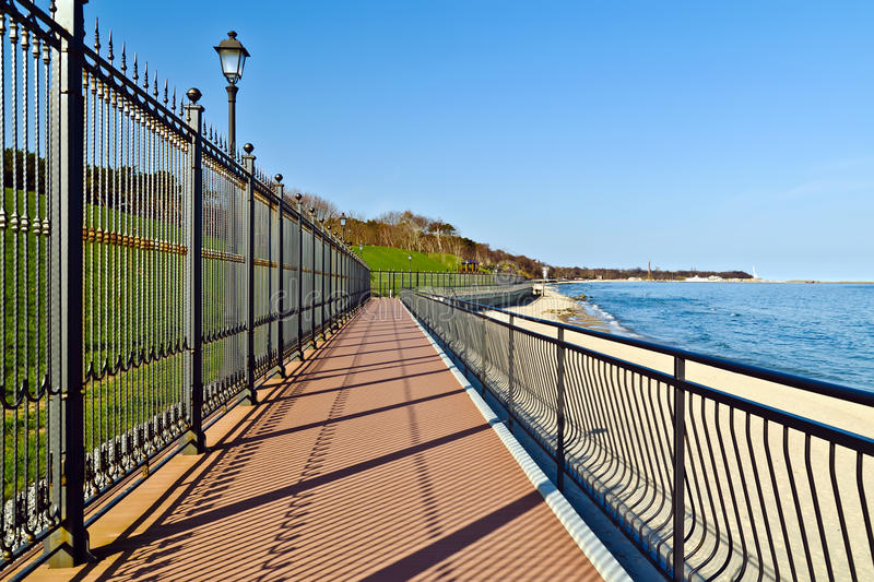Promenade along the State residence of the Russian Federation. City of Pionerskiy, Kaliningrad region, Russia. Promenade along the State residence of the Russian royalty free stock photography