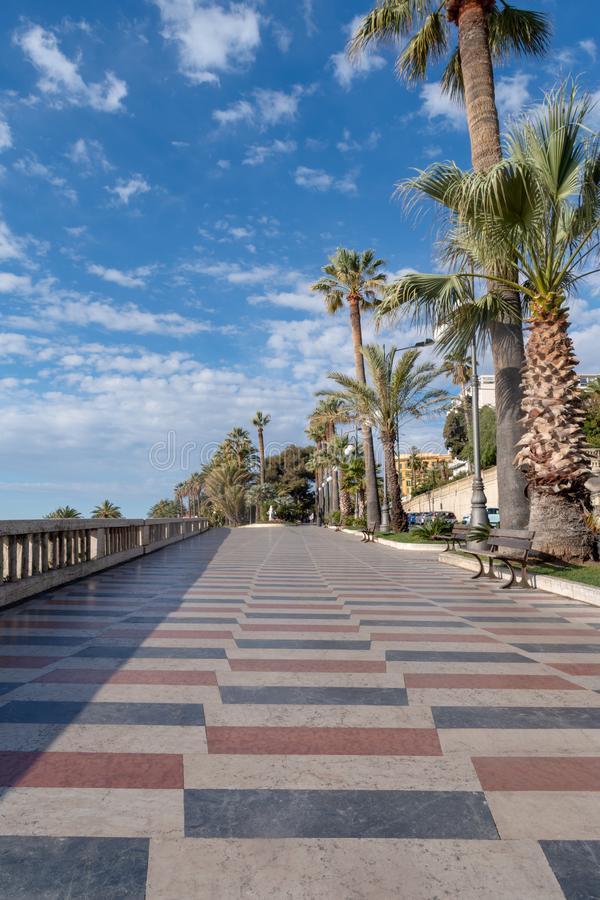 Promenade of the Empress Corso Imperatrice, Sanremo, Italy. Sanremo, Italy. Promenade of the Empress Corso Imperatrice flanked by palm trees, alongside the sea stock photography