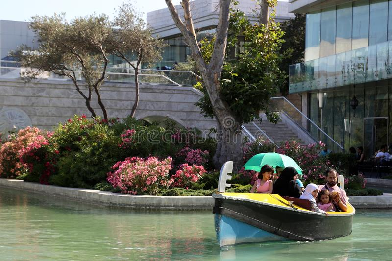 The promenade gondola floats along the water channel system royalty free stock photography