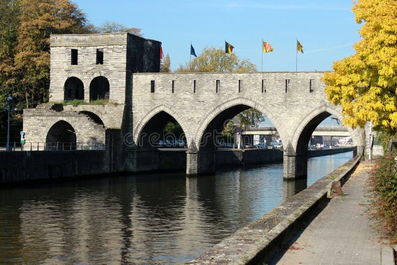 Promenade le long du quai Notre-Dame aTournai en Belgique en automne. Pont des trous en perspective. Promenade le long du quai Notre-Dame a Tournai en royalty free stock photo