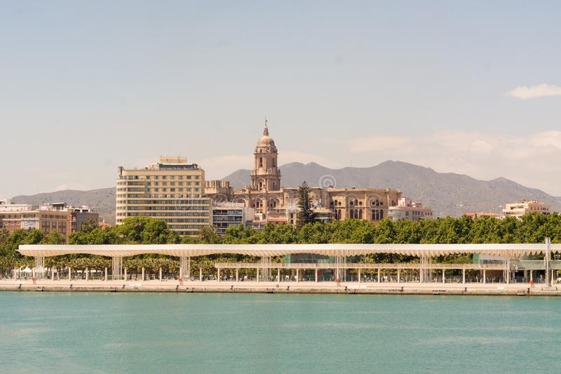 Malaga port with Cathedral of Malaga. A promenade in Malaga port and the Cathedral of Malaga in the background stock image