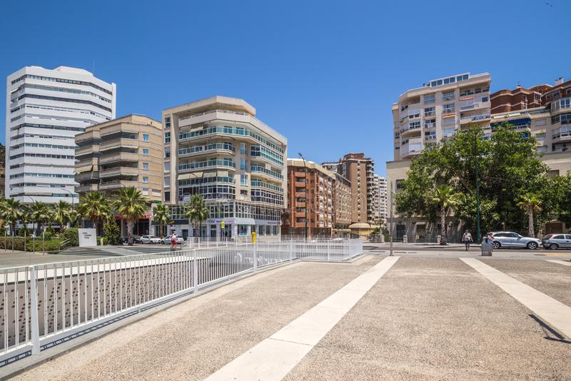 Promenade of Malaga. Spain. Malaga, Spain - June 20, 2018: Promenade of Malaga with a view of the pedestrian area, the port, the Ferris wheel and cafe royalty free stock photo