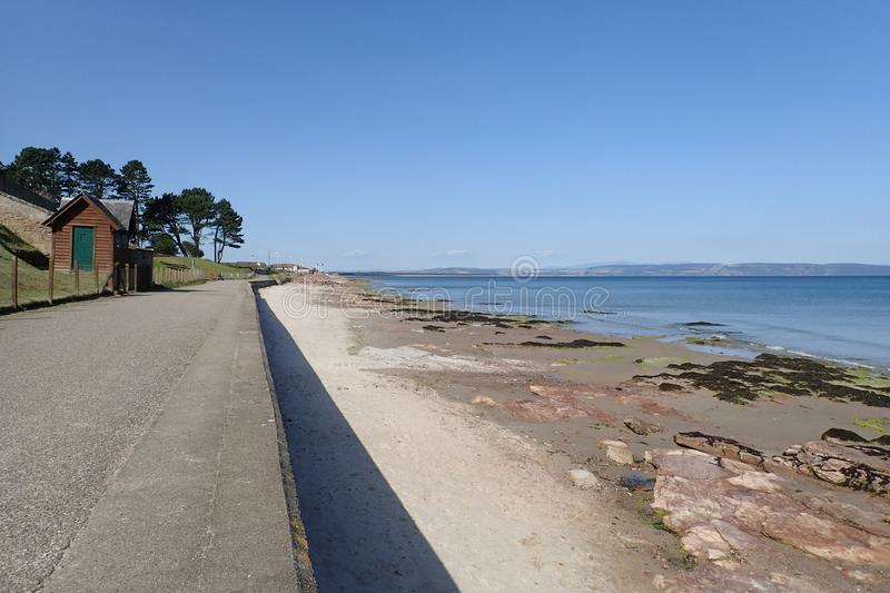 The Promenade at Nairn West beach on a summers day. View from the promenade at Nairn west beach, across the Moray Firth to the Black Isle. Taken on a bright stock images