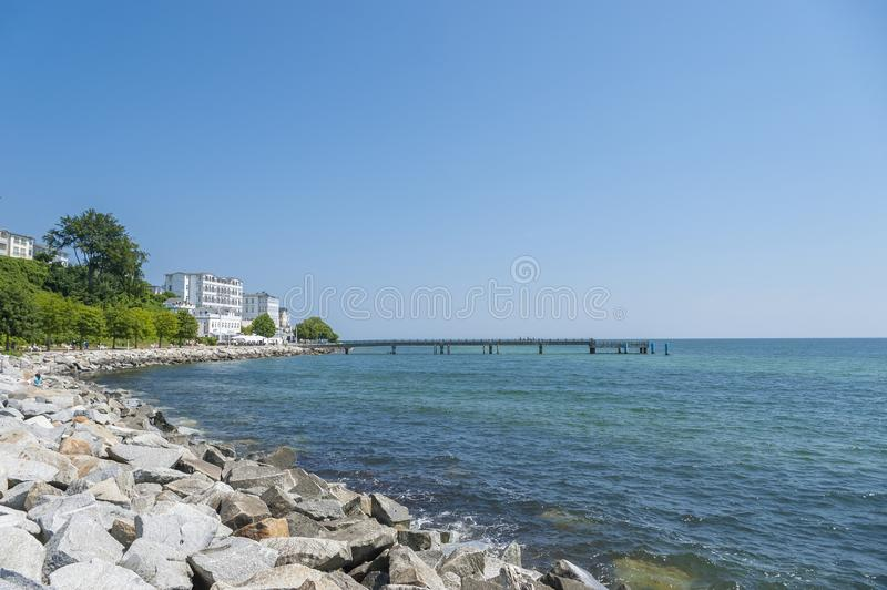 Promenade with pier and hotel Fürstenhof in Sassnitz on the isl. Promenade with pier and hotel Fürstenhof, Sassnitz, Rügen, Mecklenburg-Vorpommern royalty free stock images
