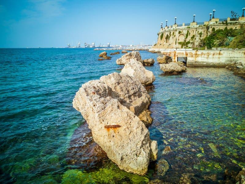 Promenade with rocks and round panoramic balcony in the city of Taranto in Italy. Taranto, Italy. Promenade with rocks and round panoramic balcony in the city stock photo