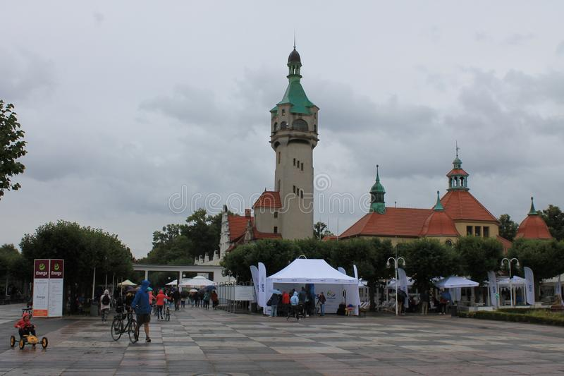 Promenade in Sopot Poland with people walking under umbrellas in the rain stock photo
