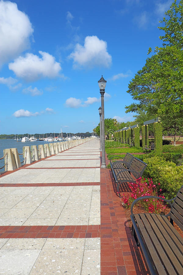 Promenade on the waterfront of Beaufort, South Carolina vertical. Promenade of the Henry C. Chambers Waterfront Park located south of Bay Street in the Historic stock photo