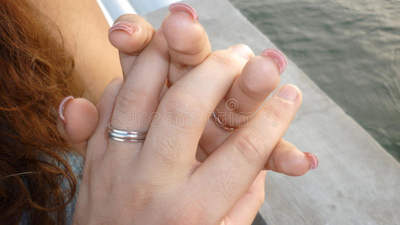 A Promise of Love. Honeymoon of just married couple two rings of white gold. Bride and Husband making a promise of forever loving each other stock image